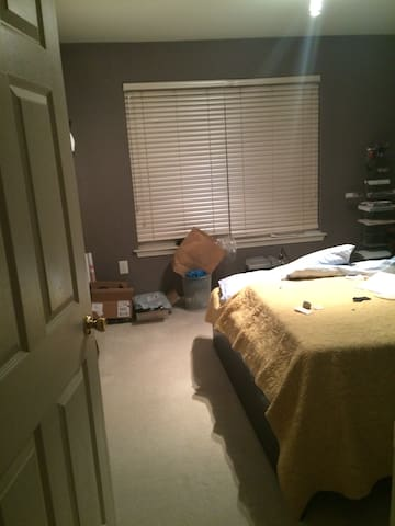 Bedroom with queen bed and bathroom - Clifton
